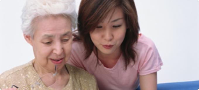 elderly woman with her grandchildren