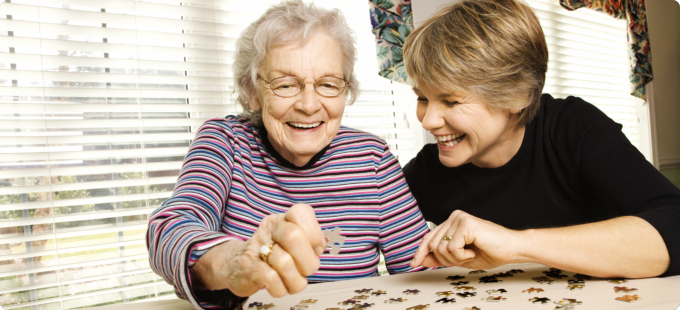 elderly woman playing puzzles