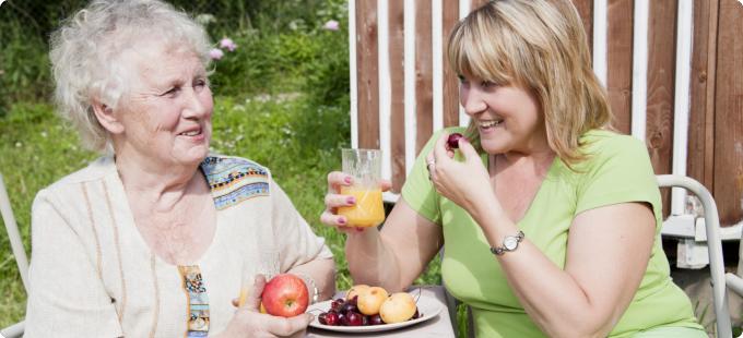 two woman having their snacks